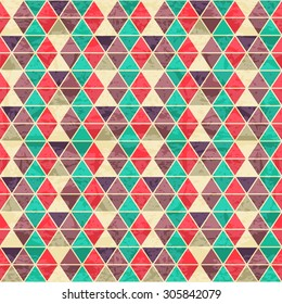 Geometric seamless pattern with colorful equilateral triangles. Eps 10 with a grunge texture. Vintage style backdrop