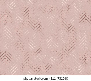 Geometric seamless pattern with diagonal rose gold bricks.