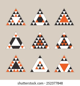 Geometrical tile equilateral triangles icons set - Modern flat design in orange, black, and white on khaki background