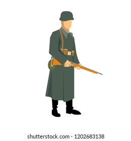 German soldier during the second world war, standing with a carbine in his hands. Dressed in an overcoat