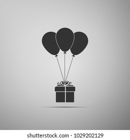 Gift box with balloons icon isolated on grey background. Flat design. Vector Illustration