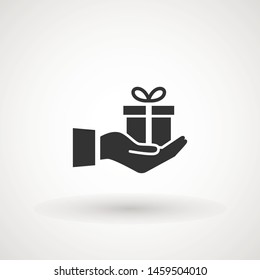 Gift box in hand. Pictograph of email in hand box . Vector icon 10 EPS.