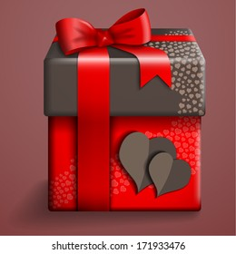 Gift box with hearts and red ribbon.