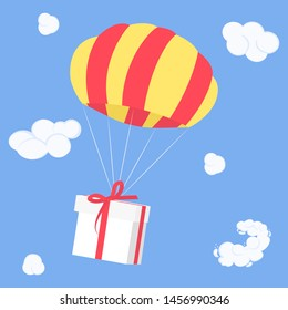 Gift is flying on parachute, delivery coming from the sky