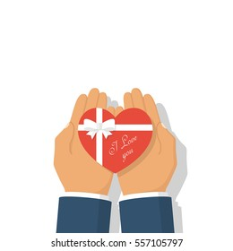 Gift heart on Valentine's Day with a declaration of love. Holding heart in palm hand with ribbon and bow. Give a gift. Vector illustration flat design. Isolated on white background.