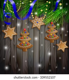 gingerbread cookies decorations on a Christmas tree with ribbon on a wooden wall