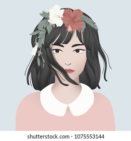 Girl with black short hair decorated with red and white hibiscus flowers and leaves