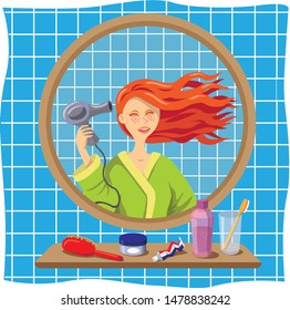 Girl blowdrying her red hair, looking in a bathroom mirror and wearing a bathrobe.