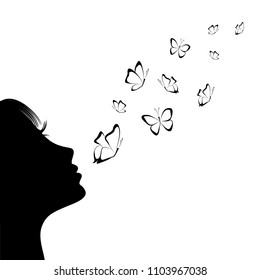 Girl blowing on butterflies. Silhouette.