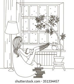 A girl with a book bag sitting in a chair and looking out the window, the window is snow on the windowsill sleeping cat.