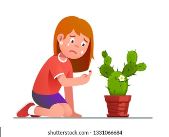 Girl crying over a cactus thorn sting pricked bleeding index finger. Upset kid looking at her blood drip from puncture injury and weeping. Child cartoon character. Flat vector isolated illustration