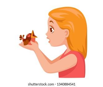 girl holding in the palms of the nestling, baby bird. nestling opened its beak
