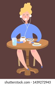 Girl listening music at coffee shop table with phone, coffee  and cake. Woman relaxing outside the house. Online education. Audio book listening.