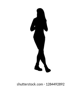 Girl with long hair taking a walk, looking away. Black silhouette isolated on white background. Concept. Monochrome vector illustration of girl in skirt and boots going for a stroll. Stencil.