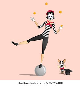 A girl mime performing a pantomime called juggling with oranges standing on a ball and a dog with a bone in its mouth