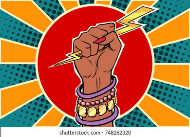 Girl power lightning in the fist. African woman. Pop art retro vector illustration
