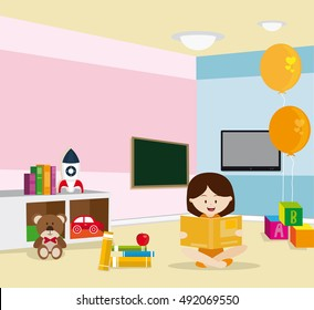 Girl reading sitting on the floor in a room with several toys