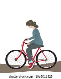 Girl rides bicycle