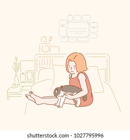 A girl sitting with a cat on a bed. hand drawn style vector doodle design illustrations.