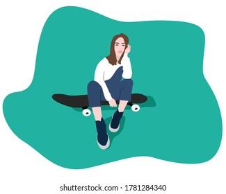 Girl sitting on a skateboard