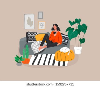 Girl girl sitting and resting on the couch with a cat and coffee. Daily life and everyday routine scene by young woman in scandinavian style cozy interior with homeplants. Cartoon vector illustration.