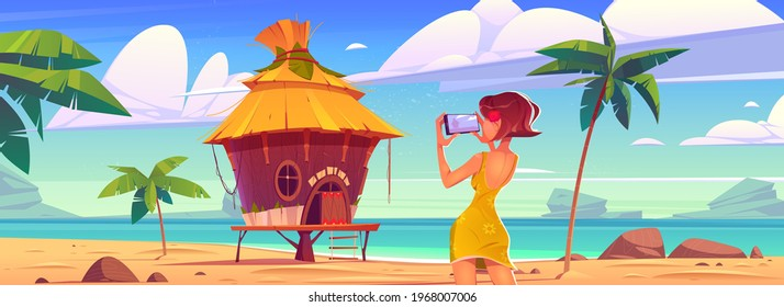Girl take photo of landscape with bungalow, sea and palm trees. Vector cartoon illustration of woman photographs ocean beach with resort wooden house on mobile phone camera