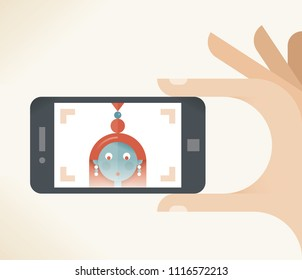 Girl taking a selfie photo holding mobile phone with her face on screen