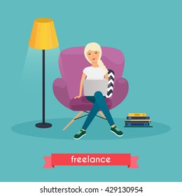 Girls working at home. Young woman sitting on a chair and using laptop. Freelance, self employed, freedom, in living room.