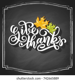Give thanks brush hand lettering with maple leaves on vintage black chalkboard background. Vector illustration. Can be used for Thanksgiving day design.