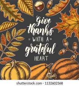 Give thanks with a grateful heart - Thanksgiving day lettering calligraphy phrase. Autumn background with leaves and pumpkins on black
