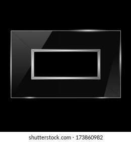 glass frame with silver trim on a black background