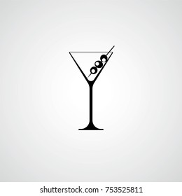 A glass for a martini. Cocktail with olives. Black silhouette. Vector