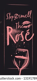 A glass of rose wine with a lipstick trace. Lettering and Quote on a Poster. Black Chalked vintage background