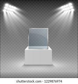 Glass showcase for the exhibition in the form of a cube. Background for sale illuminated by spotlights. Museum glass box isolated advertising or business design boutique. Exhibition hall.