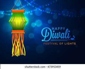 Glossy Diwali Lamp (Kandil) hanging on shiny blue night background for Indian Festival of Lights Celebration.
