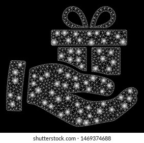 Glossy mesh present box give hand with glitter effect. Abstract illuminated model of present box give hand icon. Shiny wire carcass triangular network present box give hand.