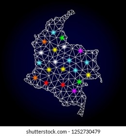 Glossy polygonal mesh map of Colombia with glow effect. Vector carcass map of Colombia with glowing multi colored points for New Year purposes. White mesh lines. Dark blue background.