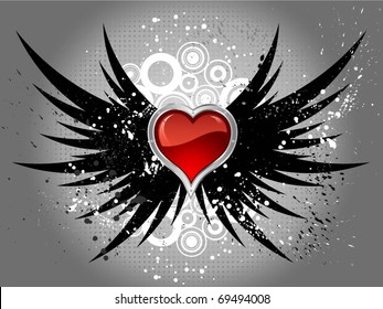 Glossy red heart on grunge wings background