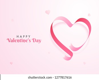 Glossy ribbon arranged in heart shape on pink background for Happy Valentine's Day poster or greeting card design.