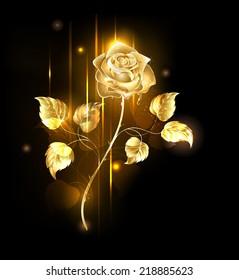 Glowing golden rose on black background.