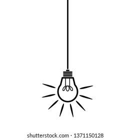 glowing light bulb hanging on cord symbolizing an idea