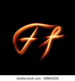 Glowing light letter F. Hand lighting painting