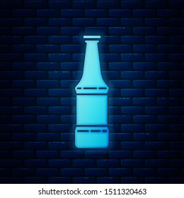 Glowing neon Beer bottle icon isolated on brick wall background.  Vector Illustration