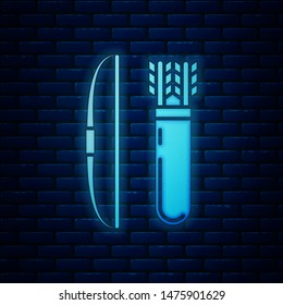 Glowing neon Bow and arrow in quiver icon isolated on brick wall background.  Vector Illustration