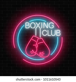 Glowing neon boxing club sign in circle frames on dark brick wall background. Fighting club neon signboard. Nightlife advertising symbol of sport facility on boxing theme . Vector illustration.