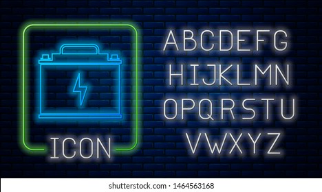 Glowing neon Car battery icon isolated on brick wall background. Accumulator battery energy power and electricity accumulator battery. Lightning bolt. Neon light alphabet. Vector Illustration