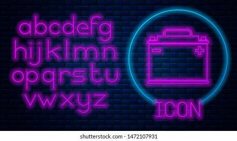 Glowing neon Car battery icon isolated on brick wall background. Accumulator battery energy power and electricity accumulator battery. Neon light alphabet. Vector Illustration