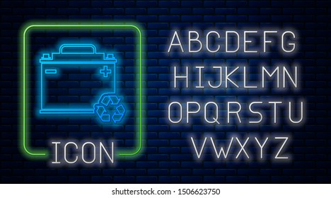 Glowing neon Car battery with recycle icon isolated on brick wall background. Accumulator battery energy power and electricity accumulator battery. Neon light alphabet. Vector Illustration