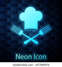 Glowing neon Chef hat and crossed fork icon isolated on brick wall background. Cooking symbol. Restaurant menu. Cooks hat.  Vector Illustration