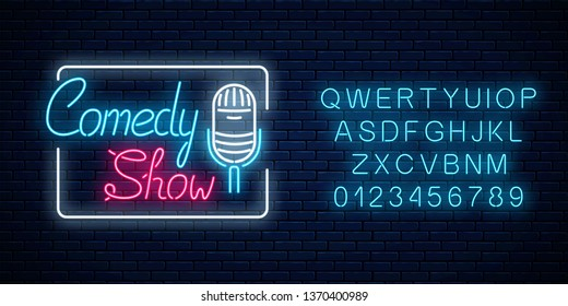Glowing neon comedy show sign with retro microphone in rectangle frame with alphabet on a brick wall background. Humor monolog glowing signboard. Vector illustration.